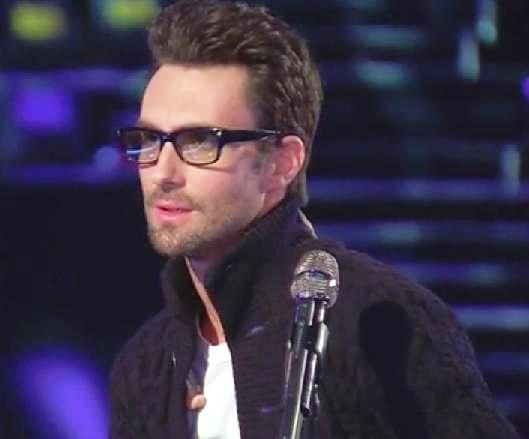 Adam Levine He wears glasses?  It totally changes the shape of his face! He looks a lot hotter in my opinion.