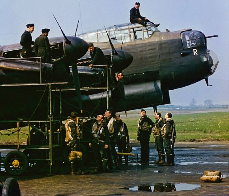 Lancaster B.Mk1 W4118 ZN-Y 10Sqn Commander Guy Gibson with his crew stands in front of his bomber 'The Admiral Prune' at RAF Syerstone March 1943