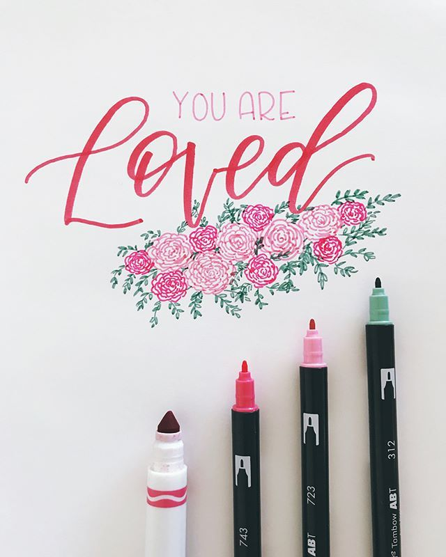 You. Are. Loved.  It's true! And not just in February (of course), but always. Especially by your mom. Or your dog. ‍♀️ . I used my @crayola marker to write the word loved & the skinny side of these three @tombowusa Dual Brush pens for the rest! Swipe to see me draw a bunch of flowers- ⚠️ not a flower expert, just trying something different! . This is the first prompt for February's #lettermore2018 - grab a pen, letter it yourself, & post under the hashtag! If you're feeling shy, you ca...