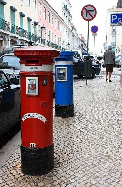 "Lisboa.mail box and trash can."","