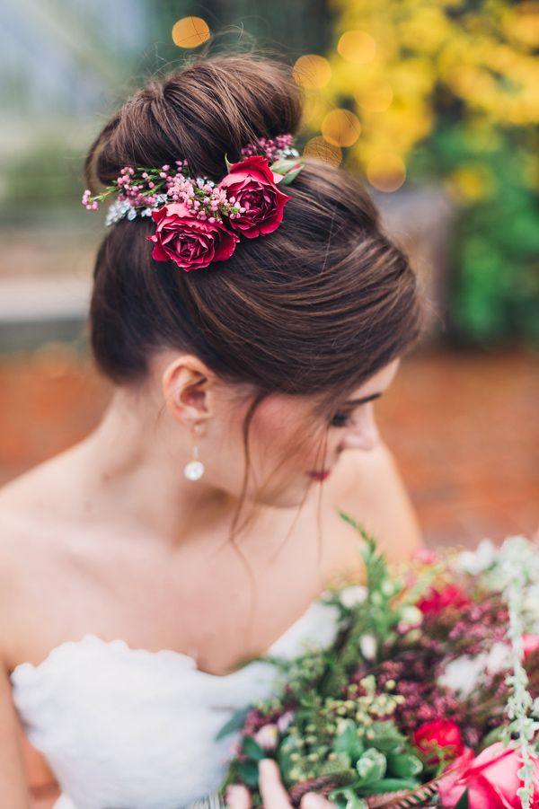 wedding hair with flowers - photo by Colleen Stepanian Photography http://ruffledblog.com/romantic-styled-wedding-at-terrain #bridal #bridalhair #updo