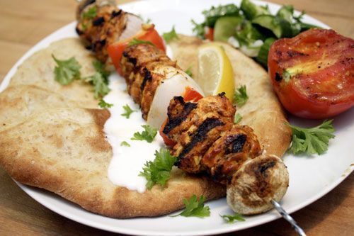Moist chicken kababs (Shish Tawok). You can use roasted tomatoes instead of the mushrooms in the recipe and also can put it in the oven if you dont have a grill. In this other recipe on another site there is a trick for how to make the chicken extra moist http://www.mamaslebanesekitchen.com/poultry/shish-tawook-chicken-kabob-recipe/ . I let the chicken marinade for a whole day, much tastier. Eat with basmati rice and the grilled vegetables.