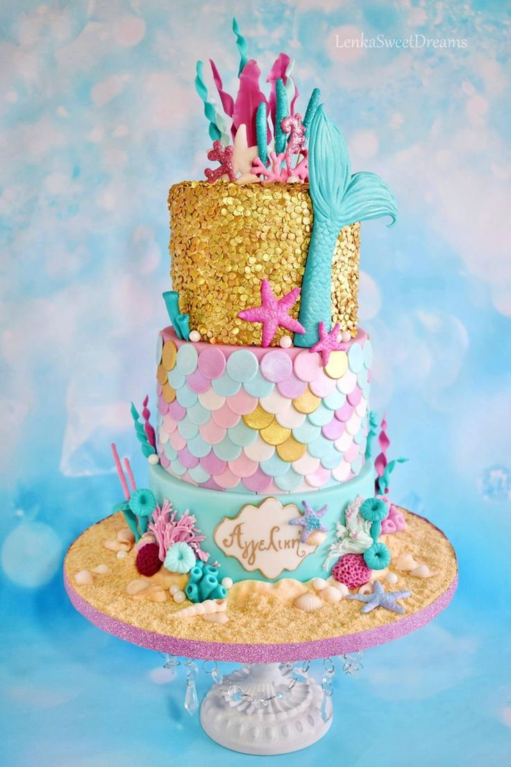 Mermaid Sequins Cake. Mermaid birthday cake with gold sequins, corals and shells for a little girl.
