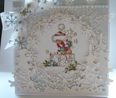 Handmade Christmas card.Memory box dies used. Christmas bears present-lili of the valley stamp. This card was hand crafted by klare chambers
