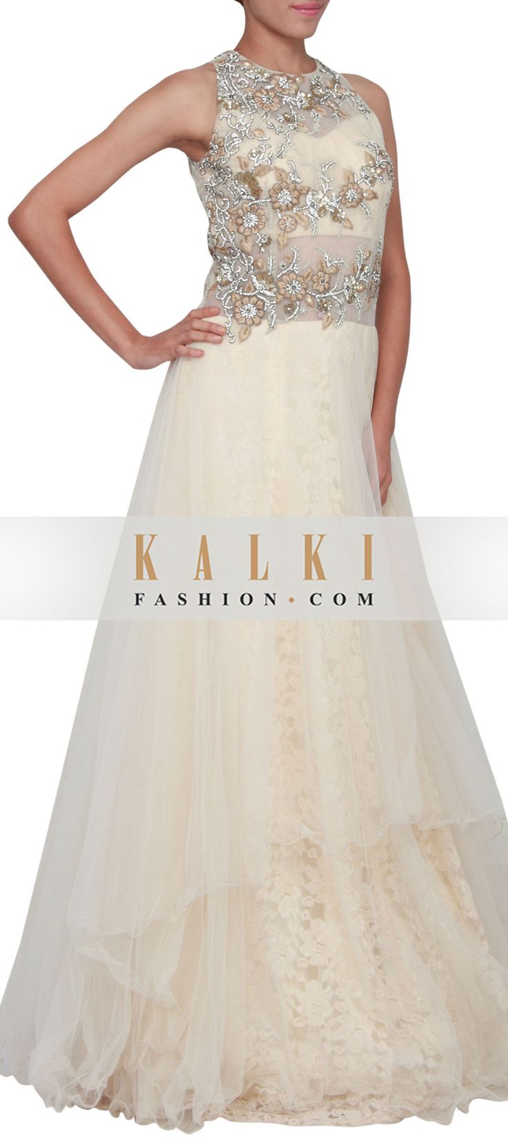Buy Online from the link below. We ship worldwide (Free Shipping over US$100) http://www.kalkifashion.com/beige-gown-featured-in-net-embellished-in-resham-pearl-and-kundan-only-on-kalki.html