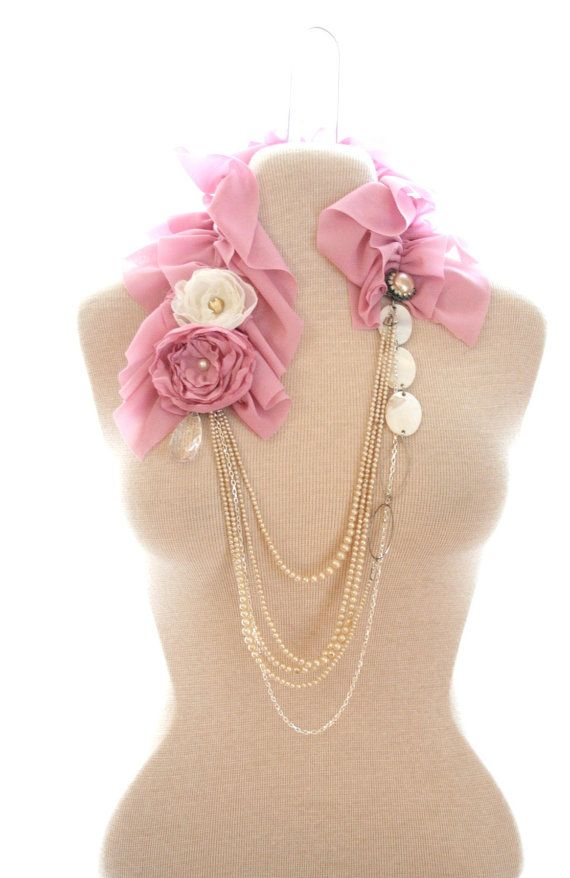 Pink fabric flowers and vintage pearls are part of this beautiful statement necklace.