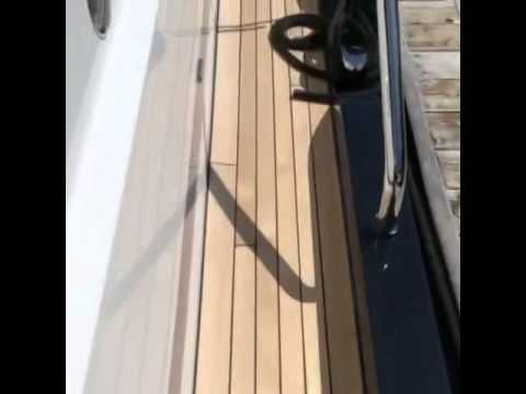 Teak decking recently completed on a new yacht ,new build in aluminum , fastenless installation http:www.idealteak.com