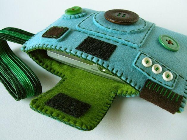 Cute camera case/phone case. I think it would make a cute purse too!