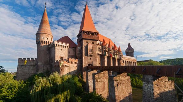 One of the most stunning Gothic-style castles in Romania, Corvinesti Castle was built on the site of a former Roman camp. With a drawbridge, 100-foot well, towering buttresses and more than 50 rooms filled with medieval art, this is one of the must-see castles in Transylvania.