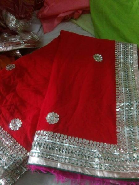 Pure georgette saree having beautiful gota hand work and butti all over saree along with contrast dupion blouse