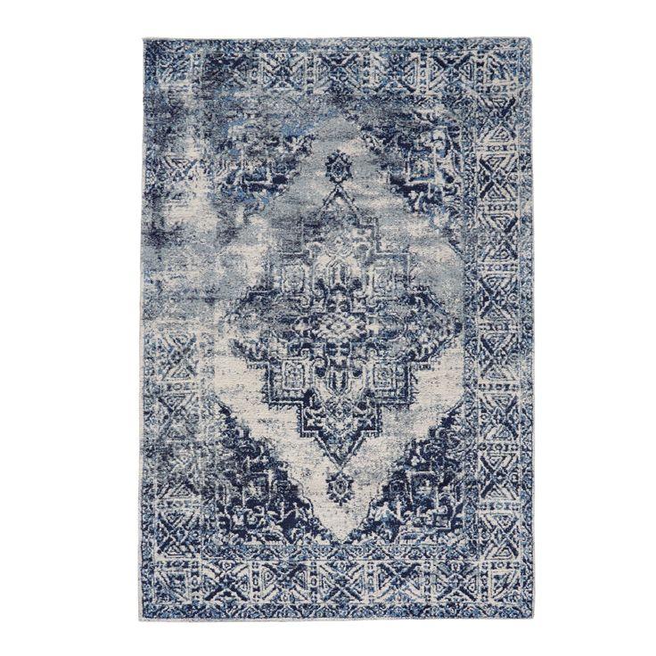 Wunderbar used! Wie ein Stück aus längst vergangenen Tagen präsentiert sich dieser ornamental gemusterte Teppich in Weiß und Grautönen.