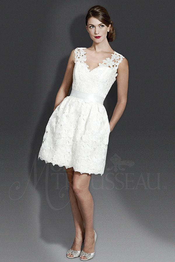 Short and sweet, this floral embroidered cotton lace dress features a V-neckline, keyhole back, side pleats, and pockets.