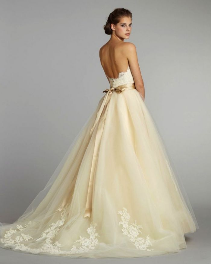 White is not always the color that women choose nowadays for Cream colored lace wedding dresses