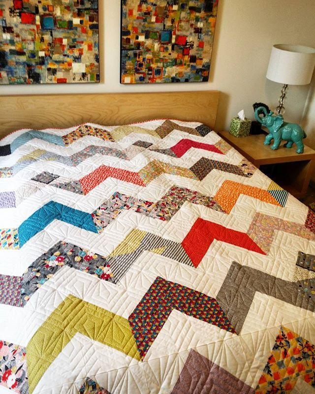 As I look up from trimming and lint rolling.. this gorgeous chevron quilt with a medley of happy fabrics, I realize it just belongs in this setting!  Nice try Krishma...but let's pack it up and send it to the rightful owner!! #longarmquilternjnyc #longarmquilting #longarmquilter #clientquilt #queensizequilts #njmqg