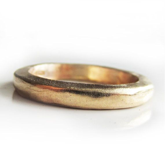 a Wonderful handmade ring made of 22 Karat yellow gold, with a hammered and beaten finish.    The wedding band measures 3mm wide and can be finished with