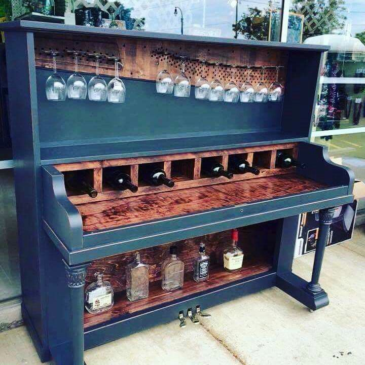 A retired piano could make an in-home drink shelf/self-serve bar. Ingenious.