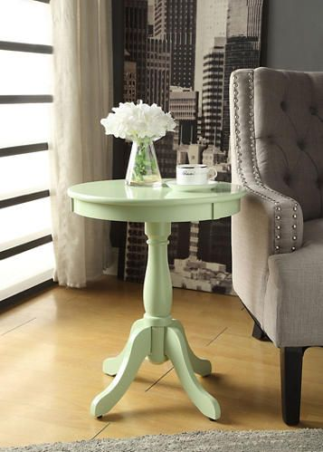 The Alger Light Green End Table Features A Round Top With A Wooden Apron, A
