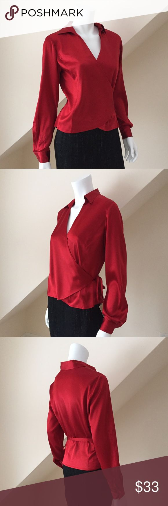 Ann Taylor Silk Blouse Ann Taylor Silk Wrap Blouse...Gorgeous shade of ruby red!...crafted from pure silk, this wardrobe essential defines refined...Point collar...Long sleeves with shirred cuffs and button closure...Button front...Shirred back yoke...Tulip hem...approx 26 1/4 long...dry clean...pre-loved in excellent condition. Stunning! Size 6. Retail $99 Ann Taylor Tops Blouses