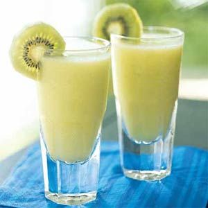 Kiwi Colada;  Here's a fun twist on the classic summertime umbrella drink. Kiwifruit and melon liqueur give the cocktail a green hue and slightly tangy flavor. Although we used green kiwi, you can substitute the golden variety for a sweeter taste and golden color.
