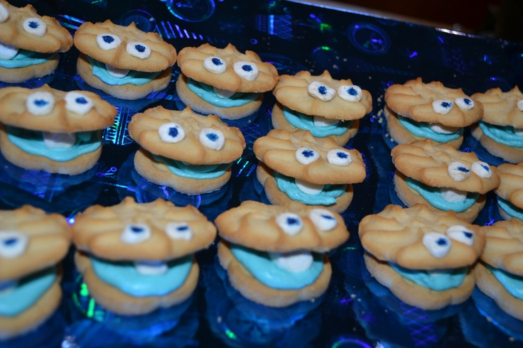 clam shell cookies made with girlscout cookies, blue icing, and marshmellow eyes - dot with food grade black marker