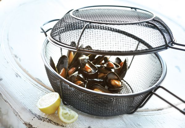 Shake things up with this 3-in-1 grill basket & skillet. For use as a skillet, deep basket or a grill basket with lid, its unique design creates a smoky flavor infusion into your foods. The sturdy, mesh design allows you to sear meats & vegetables without them slipping beneath the cooking grate. Helper handles make transportation to and from the grill easy and the basket's nonstick PTFE/PFOA free coating makes for quick clean up & safe cooking.