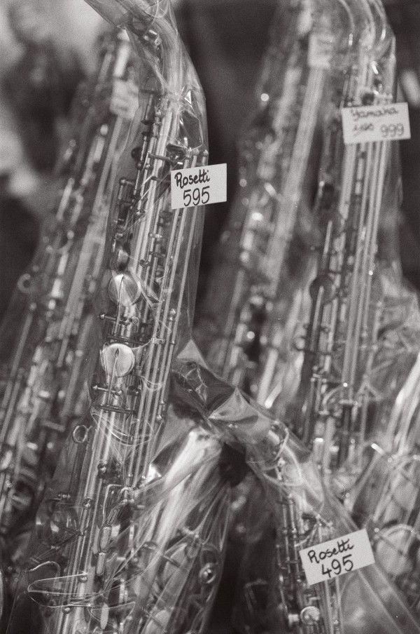 Black & white photograph of Rossetti's saxophones in the window of a music shop in Ostend, Belgium.