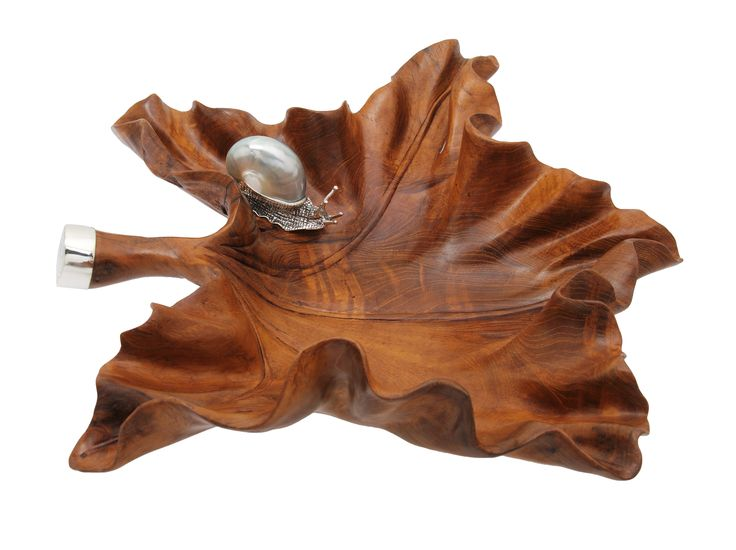 Carved from one single piece of teak wood, this beautiful leaf design decorative bowl is adorned with Sterling silver snail and silver at the end of handle.   A perfect decorative item to bring a natural touch to your home.