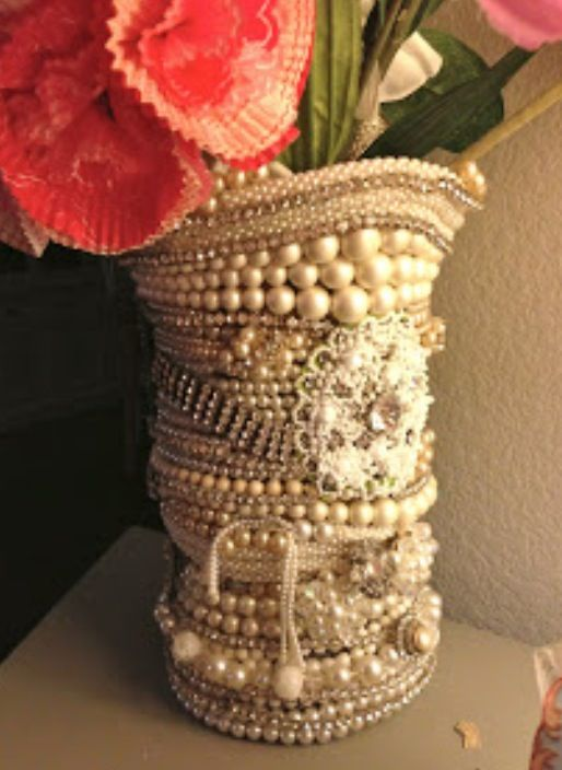 Hot glue different strands of pearls to a vase. Love!
