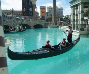 The Grand Canal Shoppes at The Venetian will transport you to romantic Venice Featuring canal, gondolas, waterfalls and more, this is definitely not your average Las Vegas mall! The highlight of this romantic mall is the Grand Canal where you can enjoy a romantic ride on a gondola and kiss under the bridge. You can also enjoy performances by dancers and costumed opera singers to soak in some culture while you are shopping in Las Vegas. The atrium icolorful waterfall and the spectacular…