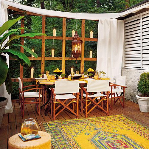Eclectic Deck - 25 Bright Ideas for Outdoor Dining - Southernliving. For this chic deck, a local craftsman created the effect of louvered blinds using pressure-treated 2 by 4s. Curtain panels made out of a weather-resistant fabric, such as Sunbrella, are hung on either side of the table using makeshift curtain rods of heavy-gauge wire.See more of this Outdoor Dining Deck Makeover