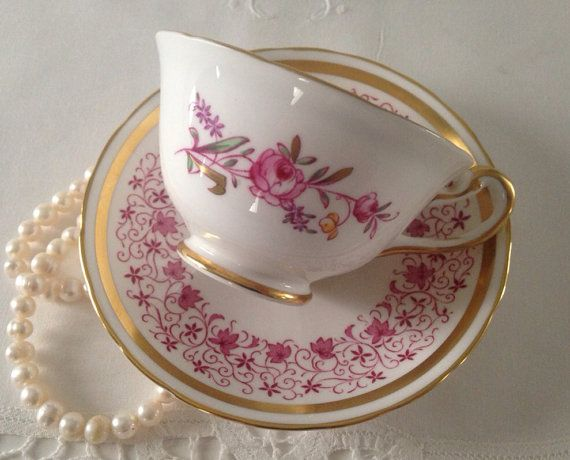 Beautiful vintage china tea cup, made by Royal Chelsea in England. This is a lovely duo in pink with gold details for the leaves and bands on both the cup and saucer. It is in good condition, no chips, cracks or crazing. Please Note: The items I sell are not new, they are vintage or antiques, it goes without saying that there maybe some imperfections which I will try my best to point out and take pictures of. I do not look at my items under a microscope, but I do the best I can to descr...