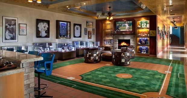 A baseball themed man cave with a carpet in the shape of a field! Click to see 10 other must-have items for the ultimate man cave.
