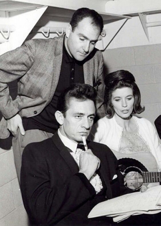 Johnny Cash and Saul Holiff with June Carter