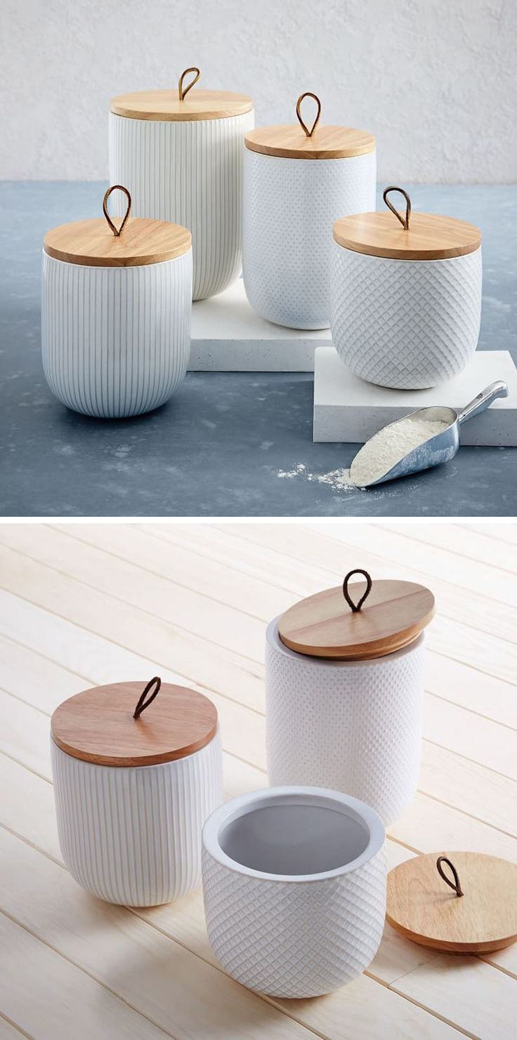With wood lids that have leather tabs, these modern white stoneware canisters have individual textured patterns, making you want to reach out and grab them.