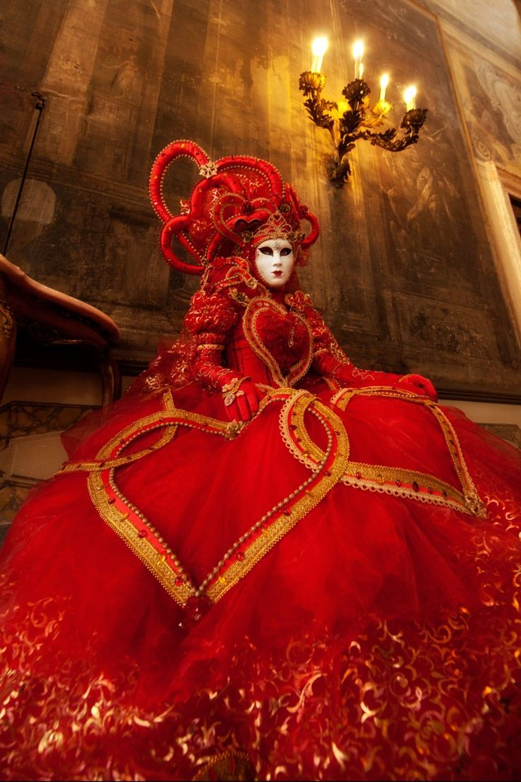 Photographer Ken Koskela // 20 Photos That Will Inspire You To Attend Carnival In Venice, Italy - January 7, 2016 - by Michael Bonocore - Bright red Carnival costume in a Venice palace