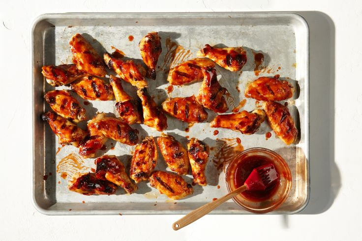 BBQ chicken wings don't get any easier than this! Use your crock pot or slow cooker to cook the wings before you finish them on the grill or in the oven. The crockpot ensures tender, juicy, fully and evenly cooked wings EVERY time. Use whatever sauce recipe or storebought bbq you prefer. FAST way to make delicious food for summer parties and entertaining. No frying required, and the results are tender, juicy wings with a caramelized, crispy skin that everyone will love.