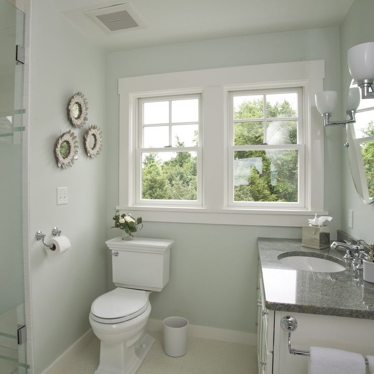 c2 paint Beach Style Bathroom Decorating ideas Providence baseboard Bath Accessories bathroom lighting beachy clean counter countertop double hung windows mirror sconce seafoam shells stainless steel toilet wall art wall decor white white bathroom white wood wood molding