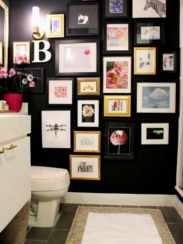 Bold Bathroom  This bathroom went from bland to striking when the homeowners traded beige walls for this moody tone. A gallery wall adds color and fun to an often traditionally styled space.