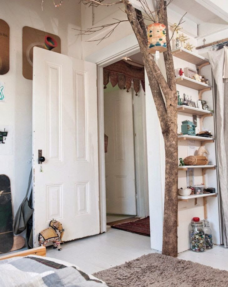 I love the thing over the door in the hallway.  And I love the placement - not prominent in this room, but visible from it.