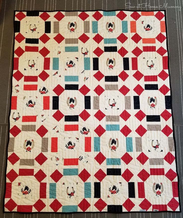 A minky-backed lap quilt featuring Birch Organic's Tall Tale in a Rolling Stone Block. Written by Erin D. of Sew at Home Mummy, Chicago IL.