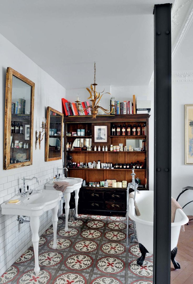 Vintage style bathroom with apothecary hutch clawfoot tub and pedestal sinks nitsa for Apothecary style bathroom vanity