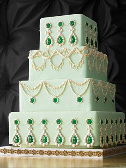Cue the Tiers: 19 Dream Wedding Cakes for George and Amal | CENTER OF ATTENTION | Amal is already sporting a massive diamond sparkler and seems to take her bling seriously. So really the question is, why not choose a bejeweled cake inspired by pieces worn by British royalty? Bonus: The pale green color will be a fitting match for all the colorful cocktails being served at the reception.