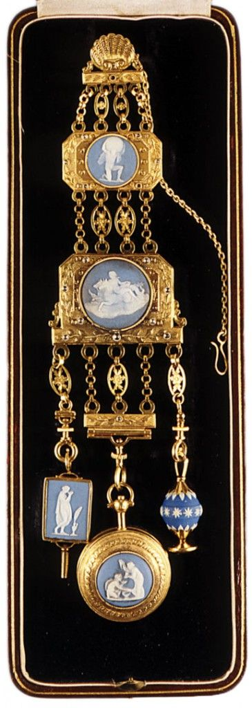 A Regency chatelaine, circa 1810s, made in gold and diamonds with jasper plaques, including a key, watch, and seal.