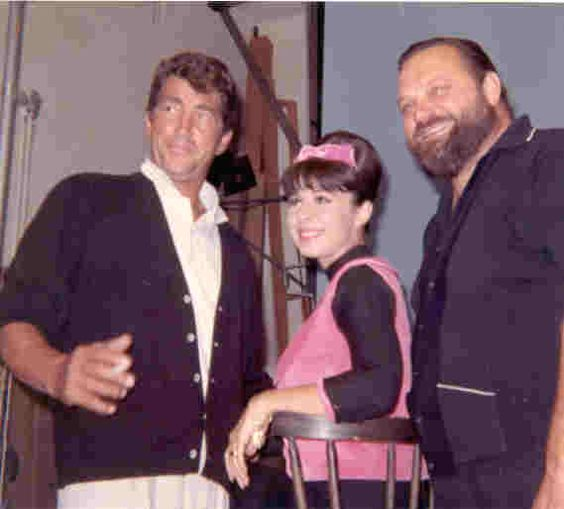 Dean Martin, Eydie Gorme and Al Hirt, take a break outside during Dean's TV show