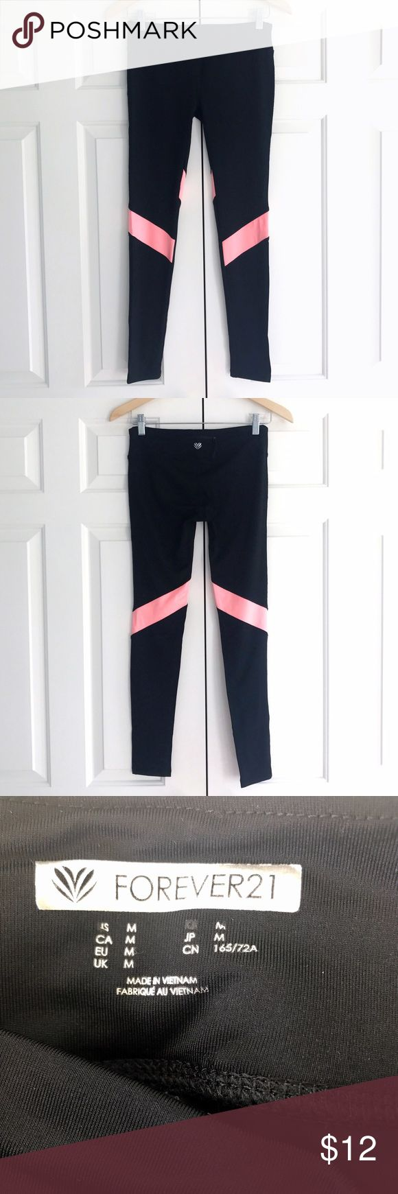 Forever 21 Workout Leggings XXII thick, black leggings with a pink stripe detail. In like new condition. ***inspired by lululemon, tagged for views lululemon athletica Pants Leggings