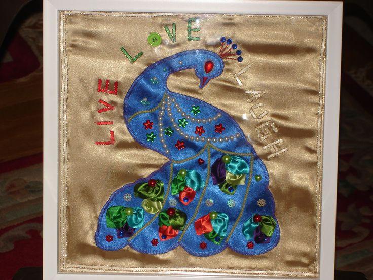 made a peacock design frame in satin cloth