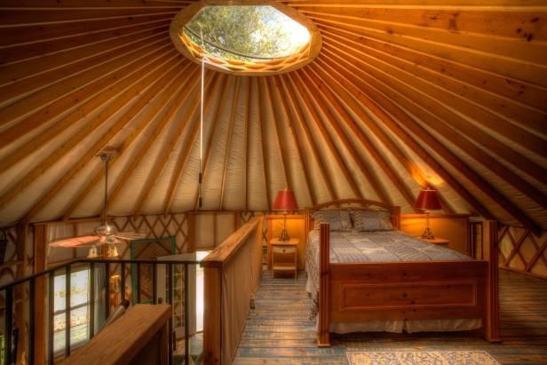 Beauty Sleep - This eye-catching concept for a loft bedroom combines natural light with the warm colors of stained and natural wood furniture. www.blueridgeyurts.com