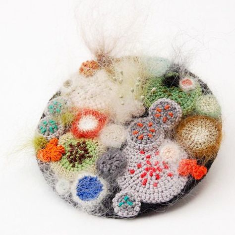 Bristol-based artist and embroiderer Elin Thomas sees beauty in the mundane, and, in much of her work: the mouldy. Inspired by the beautiful, random formations of mould and lichen she creates intricate art works and jewellery inspired by growths and spores. From brooches and needlework inspired by Petri Dishes, to Moleskine diary covers with their... tell me more!