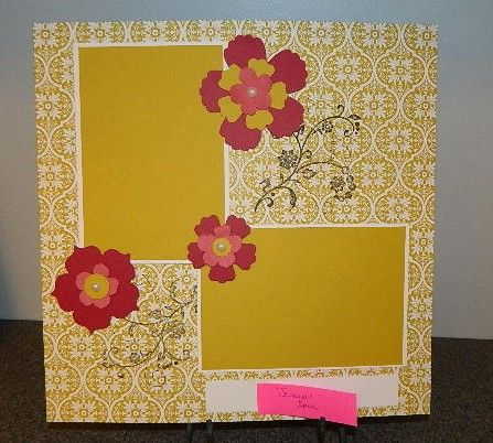 Clean and Simple Scrapbook layout. Fun Flowers die and the color combo really add pop to this page.