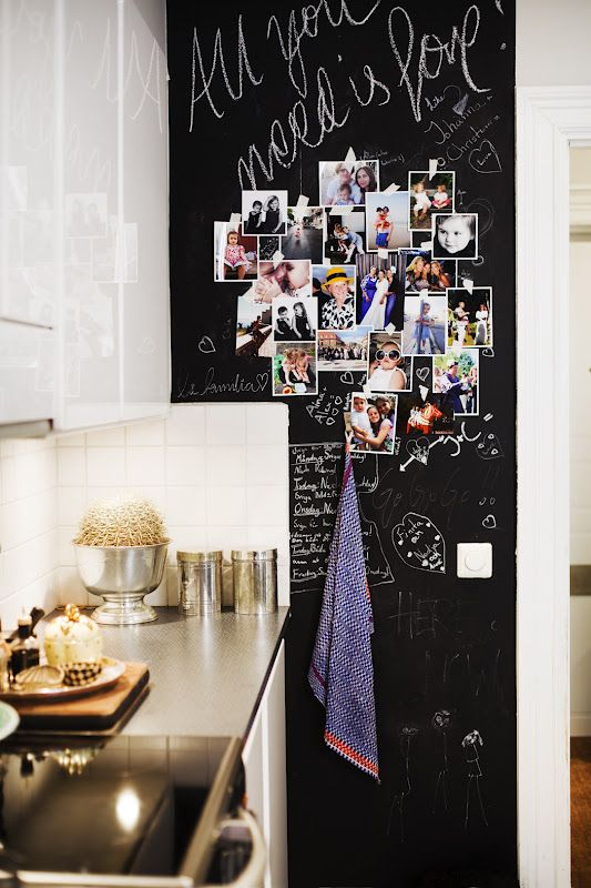 Chalk board kitchen wall in a European kitchen.. memories and photos close to your heart in the kitchen... sweet